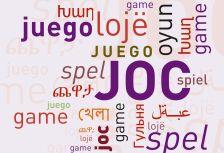 Detall del cartell anunciador del DILM a Montcada i Reixac, amb la paraula joc en diferents idiomes